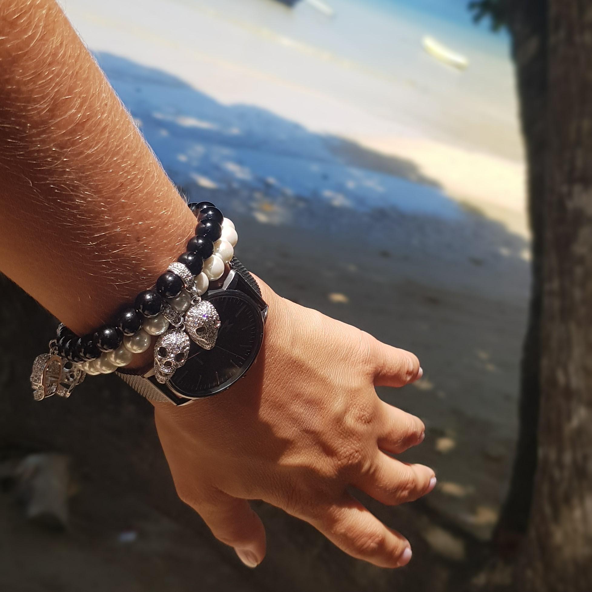 wearing skull bracelets