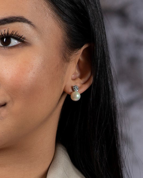 girl wearing pearl silver earrings london jewelry